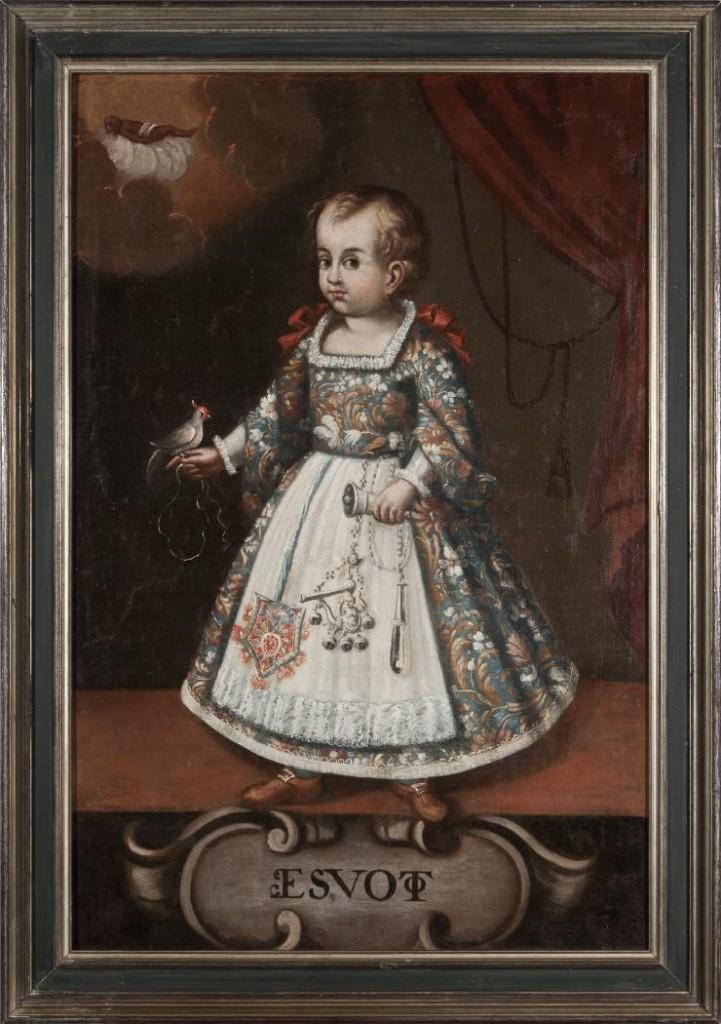 Exvoto del siglo XVII. Óleo sobre lienzo que representa a un infante ataviado al gusto de la época y portando un cinturón de amuletos en el que destacan una campanilla, un chupador de vidrio, un sonajero de sirena y una bolsa de tela. Fuente: http://ceres.mcu.es